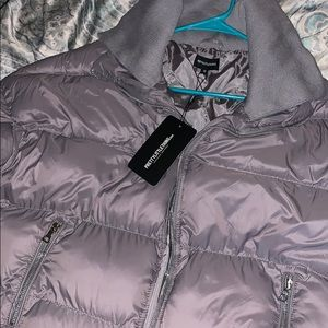 Grey puffer jacket with zipper pockets